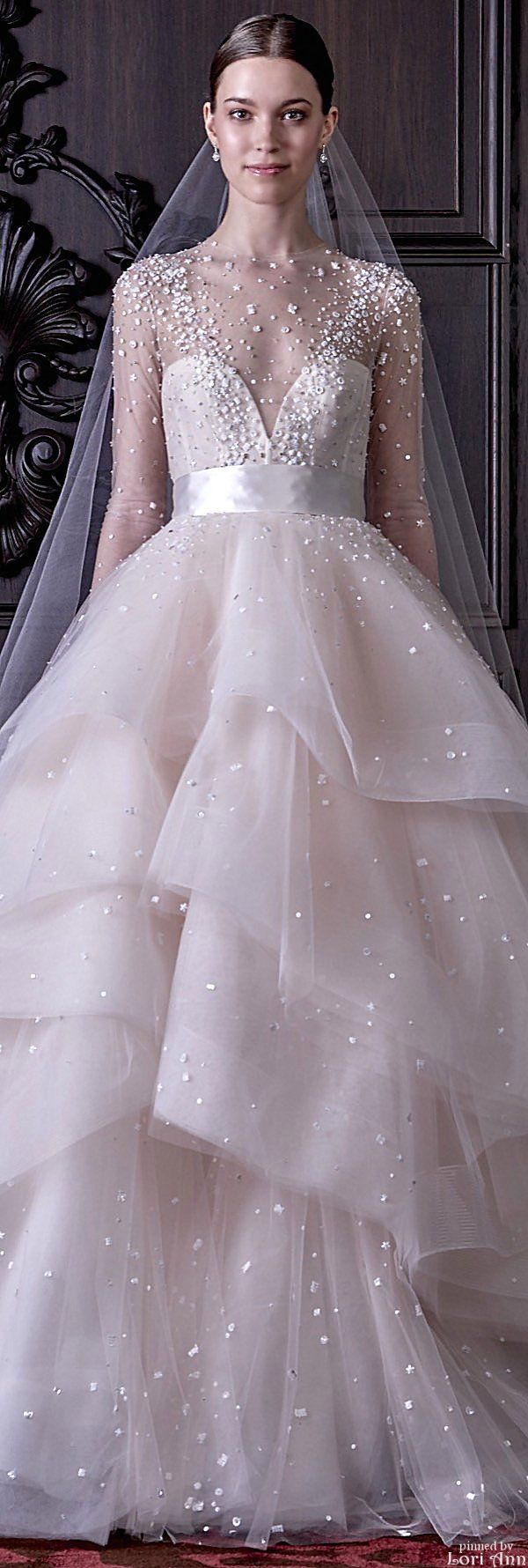 Monique Lhuillier - interesting detail on the tulle. Not a fan of the ribbon at the waistline.