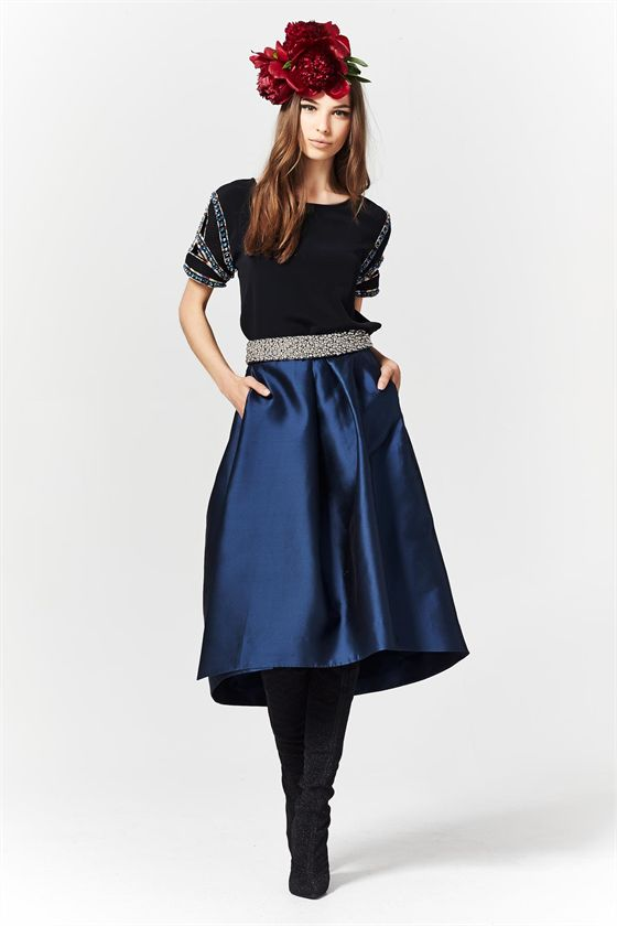 It is the season of the skirt, and the fuller the better. This metallic sapphire skirt is detailed with a pleat in the front giving it an unexpected shape. The lustrous fabric takes it from day to evening with ease. Winter 2015 Size & Fit: Model is 177cm tall Model wears a NZ 8/ EU 36/ US 6 Wash Guide: Dryclean highly recommended. Cool gentle hand wash in approved mild detergent. Do not bleach. Wring. Rub. Tumble dry. Line dry inside out in shade. Cool iron on reverse side with care. Dry...