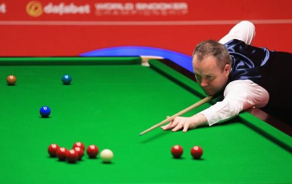 John Higgins has cruised into the second round of the UK Championship http://bbc.in/1uWrU0s