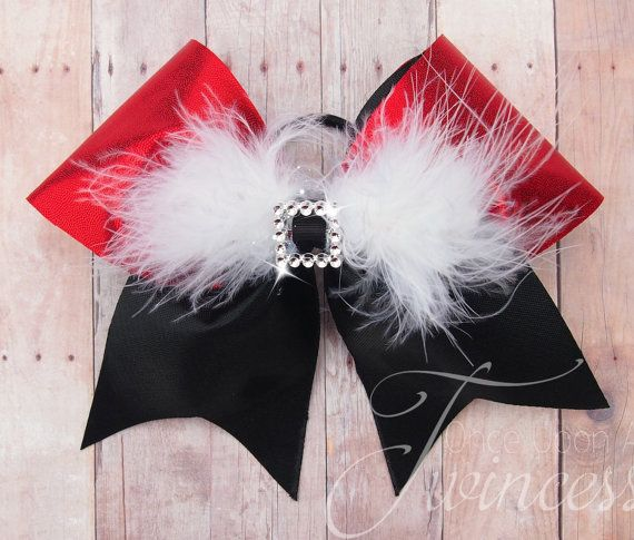 This cheer bow is made with high quality US made 3 grosgrain ribbon, mystique red and black fabric, plastic rhinestone center, and marabou feathers. It is the perfect accessory for a holiday party or holiday cheer routine. FREE SHIPPING ALERT!!!! Use code Teamorder50 for FREE SHIPPING on orders over $50.  This is attached to a goody brand pony tail holder that is made to last.  Ask me about a team order for this bow. :) My bows are made to order which means no two bows are exactly alike. I…