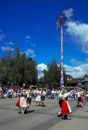 Maypole and Couples Dancing in the Street at the Leavenworth Maifest - Sunny Walter/Washington State Tourism
