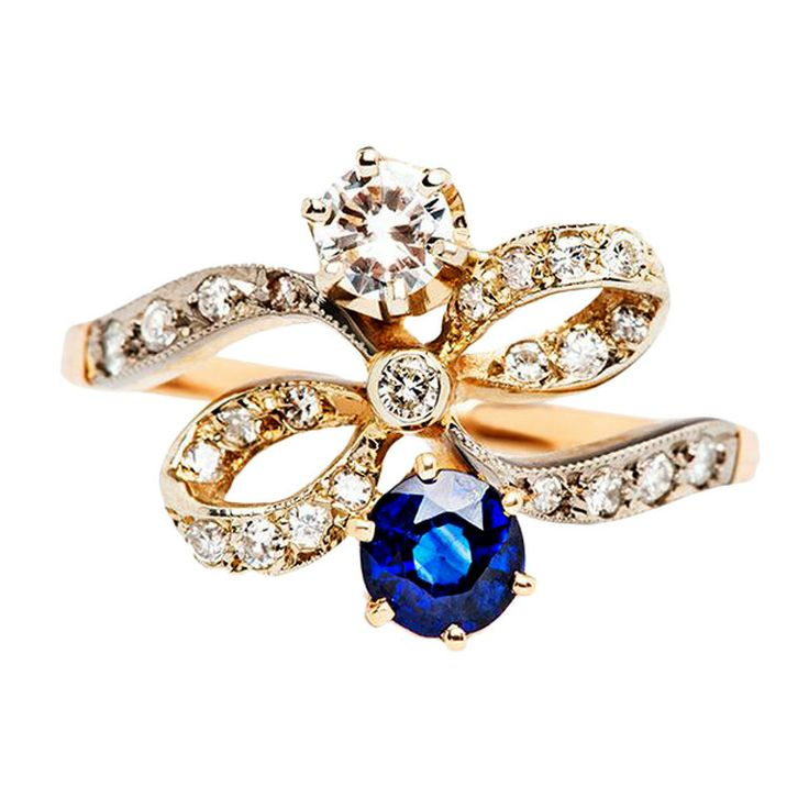 Diamond Sapphire Love Bow Engagement Ring | From a unique collection of vintage engagement rings at http://www.1stdibs.com/rings/engagement-rings/