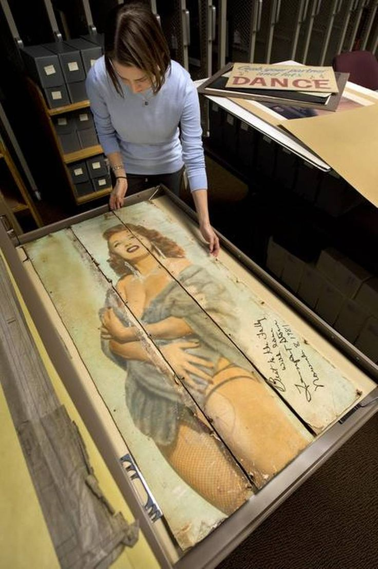 The Folly Theater has donated posters, autographed photos, contracts and other items from its 114-year history to the Kansas City Public Library. Last week, archivist Kate Hill inspected a poster of striptease artist Tempest Storm, who signed the artifact when she came to Kansas City in 1981 for the Folly's reopening celebration.