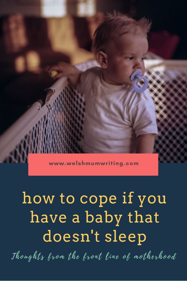 Image of a child stood in a cot and looking around, with the post title - How to cope if you have a baby that doesn't sleep