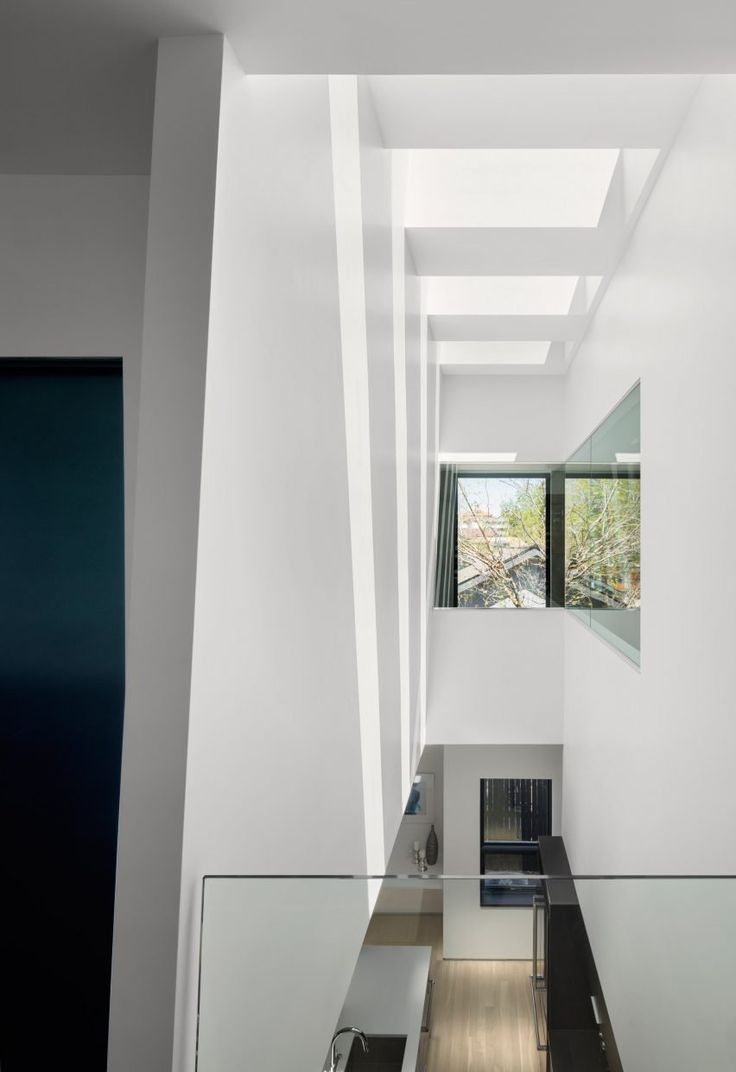 The balcony, which is accessed from the master bedroom on the first floor, is set on top of a porch created by a large gap in the pallet wall at the front of the house.