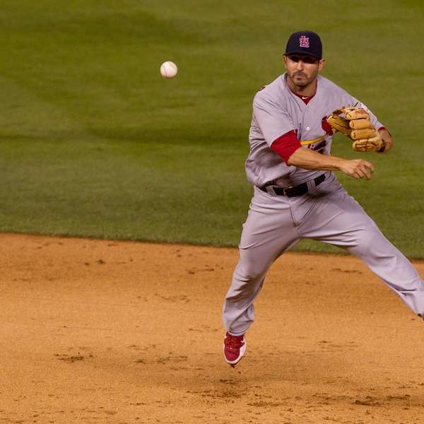 July 31, 2012. SS Daniel Descalso makes an acrobatic throw to nab the runner.: Photo