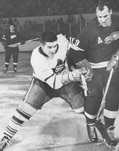 Gordie Howe in action against the Toronto Maple Leafs Tim Horton in 1957.