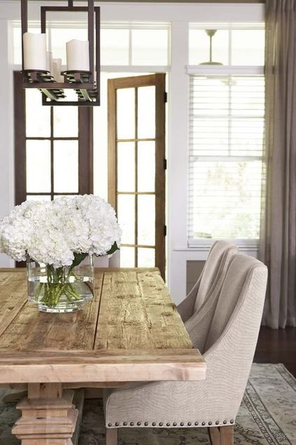 rustic table with modern plush comfy chairs---------------raditional dining room by Linda McDougald Design | Postcard from Paris Home