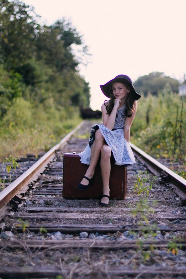 vintage tween photo shoot with an old suitcase on train tracks.