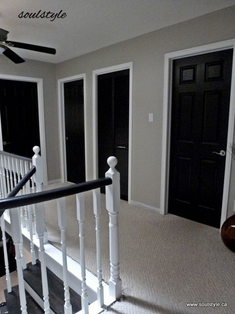 "Black Interior Doors, white trim. Two coats SW all surface lacquer in ""caviar"" using 1-12/"" angled brush for panel details, small foam roller on rest for smooth finish. SW ""oxford white"" for trim. SW ""revere pewter"" walls."