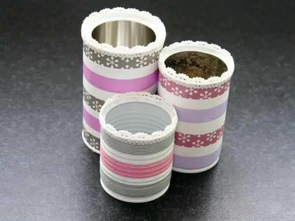 A nice way to store your pencils: Made out of old cans, painted white with acrylics (or gesso) and customized with masking tape.