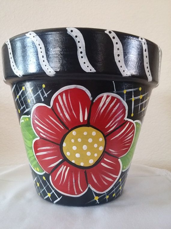 Beautiful hand painted pot in primary colors makes for great secos or give as a gift. Show how much you appreciate your childs teacher by gifting them this beautiful flower pot!  Just add some greenery or think outside the box and fill it with teacher supplies such as markers, rulers, pens, pencils, etc...  This Italian clay pot is hand painted using acrylic paint and poly sealed to protect the design. Indoor / outdoor use  Measures 7 inches tall and is 7.5 inches at its widest point and 4.5…