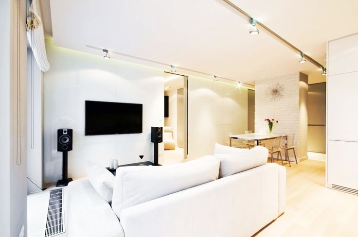 Apartment, Elegant Living Room Design Ideas With White Sofa Ideas At White Water Apartment Lightened By Track Lamp On Ceiling: Stylish and U...