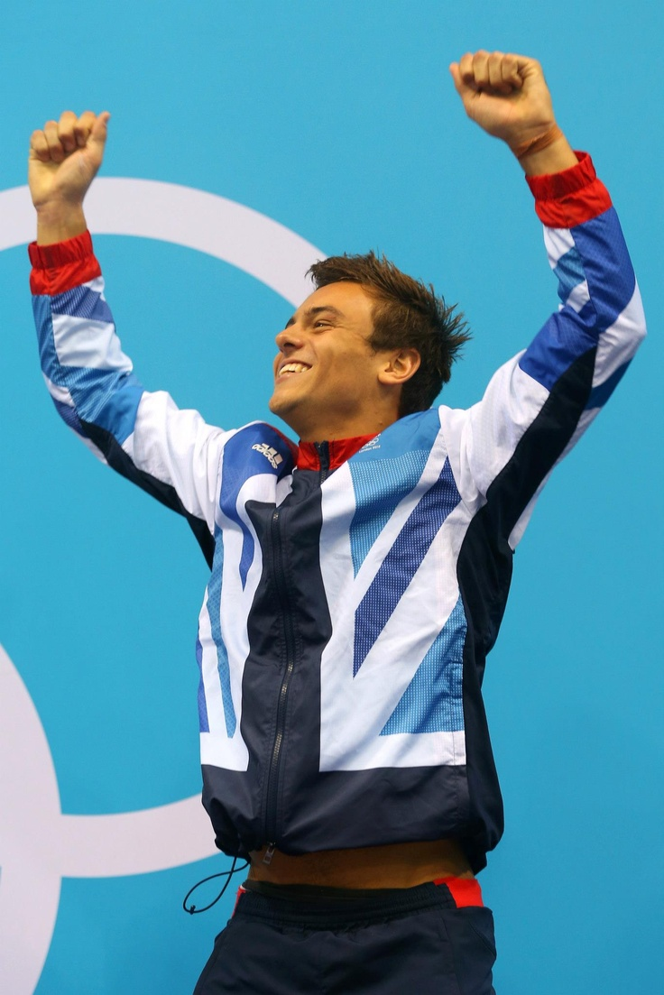 Day fifteen: Bronze medallist Tom Daley of Team GB celebrates on the podium during the medal ceremony for the Men's 10m Platform Diving Final.