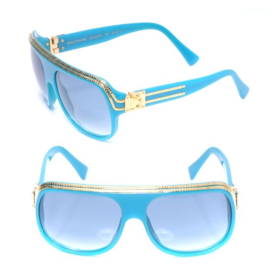 This is an authentic pair of LOUIS VUITTON Millionaire Sunglasses Turquoise w Gold.   These fabulous retro style sunglasses are turquoise with gold trim engraved with small Louis Vuitton LV logos.