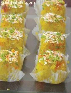 Grated coconut is cooked to perfection with sugar, milk and ghee to make this all time favourite barfi. Be very careful whilst cooking this dessert as even a few extra seconds can cause the barfi to harden up.
