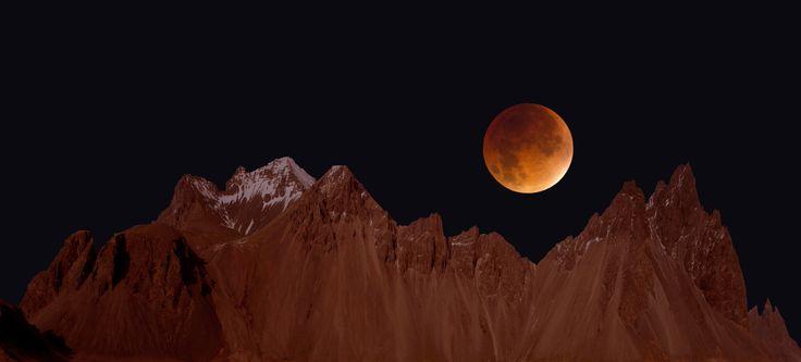 Blood moon over Vesturhorn - Composite image of blood moon over Vesturhorn in Iceland.