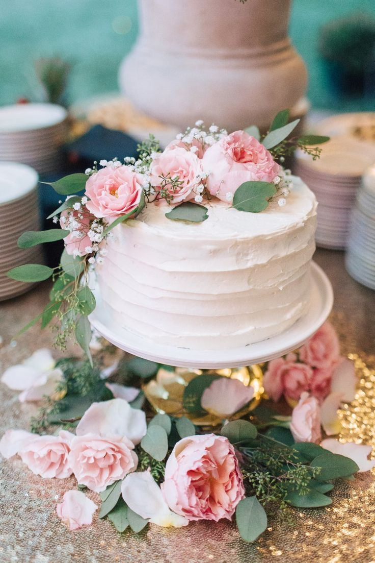Peony and eucalyptus topped wedding cake: Photography: Lauren Fair Photography - http://laurenfairphotography.com   Read More on SMP: http://www.stylemepretty.com/2017/01/18/sweet-stylish-backyard-wedding/