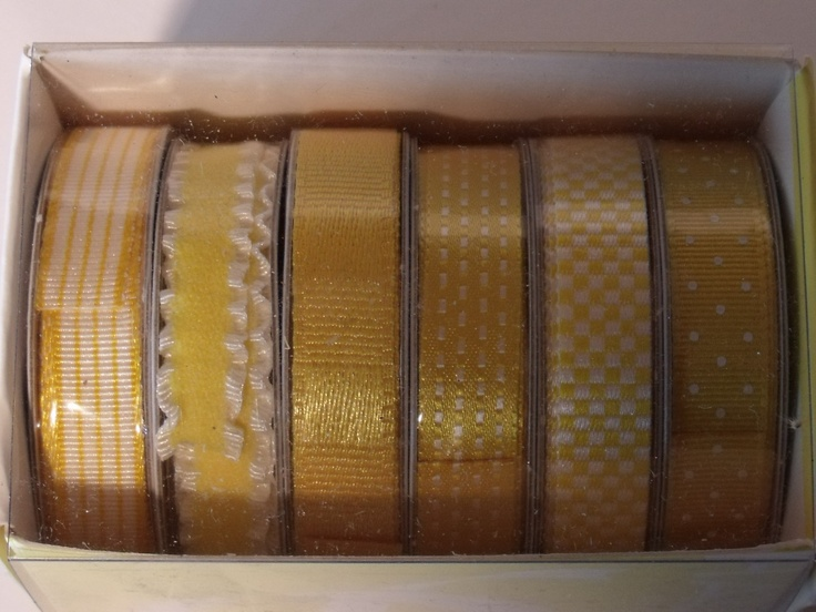 RIBBON BOX HAUTE - COSMO      Based on the classics of fashion Haute ribbon offers coordinating premium ribbon. These irresistibly coloured sets will bring textile-inspired design to any page or project. 24 ft of 3/8 inch ribbon.