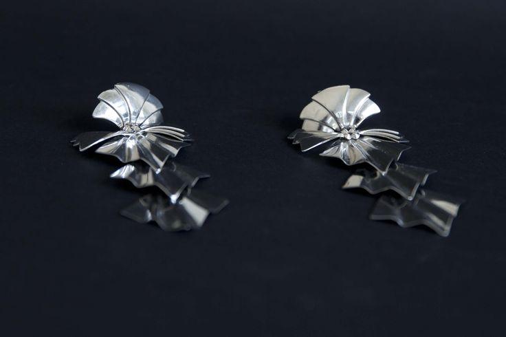 Silver plated brass earrings.
