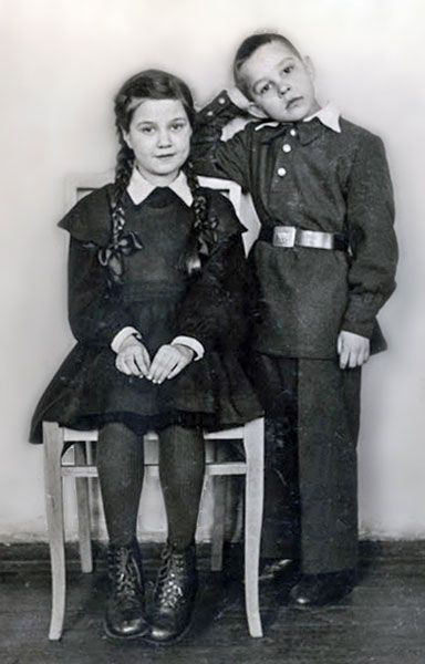 From 1943 to 1954, in most urban schools practiced separate schooling but nevertheless, uniforms introduced in 1949 and it is becoming a common and compulsory for all students of USSR. Attire for girls consisted of a brown dress with a black apron, white collar and cuffs. In the days of the solemn black apron was replaced by white. The boys were required to wear the military tunic with collar small stands.