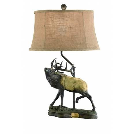 Stag Sculptured Table Lamp with Burlap Shade  This gorgeous resin cast table lamp highlights a stunning stag in high detail and has achestnut bronze finish. Featuring a sloped natural burlap lamp shade, this beautiful lighting solution would be stunning in any natural Decor. TheStag Sculptured Table Lamp with Burlap Shadeis a perfect lighting accent for all nature lovers' home and will add arusticcharm to their interiors.
