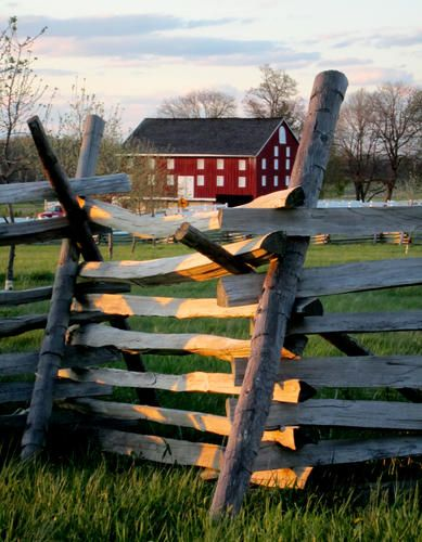 The original barn at the Sherfy Farm along Emmitsburg Road, surrounded by fierce fighting, caught fire during the Battle of Gettysburg and burned to the ground. The family rebuilt the barn shortly after the battle and today, its visible beyond fences in the Peach Orchard section of Gettysburg National Military Park.
