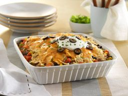 Enjoy the taste of fully loaded nachos layered and baked in this irresistible casserole