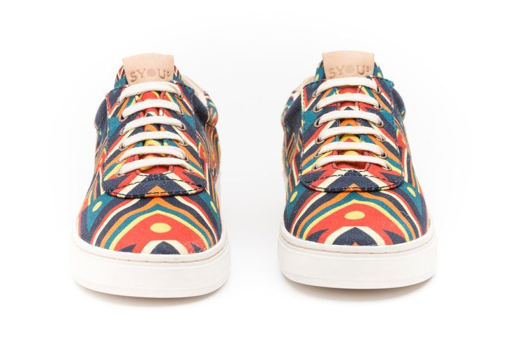 The SYOU CO.7 ANDES sneaker designed by talented artist José Argotty. Featuring a pattern based on symbology and frames found in the Andean textiles in dark blue, bright yellow and red. Get yours at SYOU.com