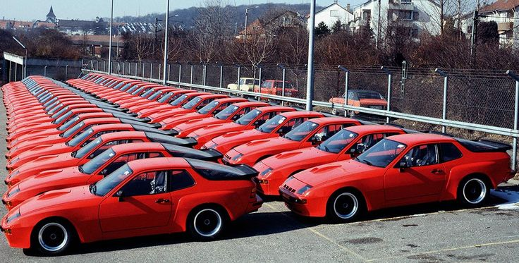Rows of red Porsche 924s