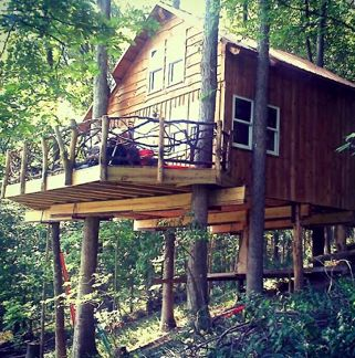 This Might be the Most Awesome Ohio Getaway Destination Ever:  Ohio DNR Mohican State Park treehouses!  Each two-story unit is equipped with two bedrooms, a stocked kitchen, a full bath, Amish-made furniture, central air, satellite TV, and, oh, a killer back porch view.