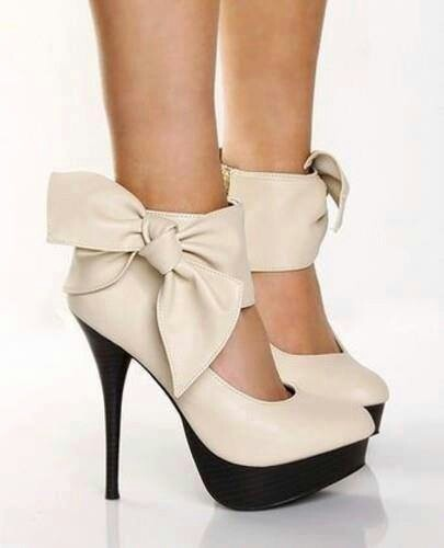 Cute Shoes with white bows! i would buy but never where because white leather is so hard to maintain.