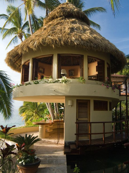 Attractive Image Ideas to Build a Luxury Tropical Homes: Agreeable Luxury Tropical Homes Exterior With Straw Roof With Cream Wall Color Also Wooden Deck Also Unique Exterior Wall Light And Wooden Dorr With Latice ~ lighthouseartscenter.org Bedroom Inspiration