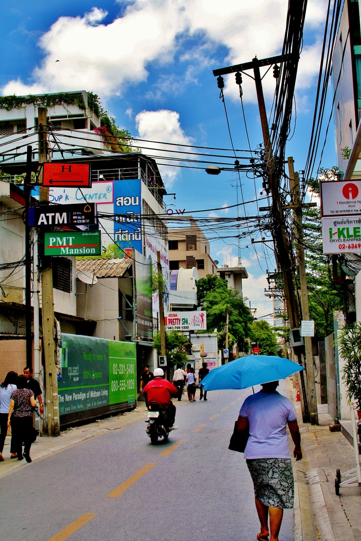 Bangkok heat.   Blue umbrella