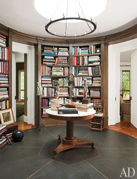 A floor of brass-trimmed leather distinguishes the library rotunda of Ellen DeGeneres and Portia de Rossi's Beverly Hills home.