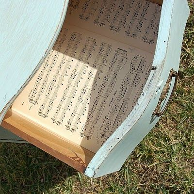 line drawers with old sheet music or book pages!!  Because it is little details like this that make the difference.