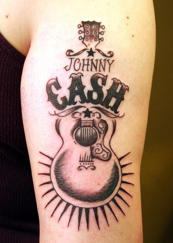 Johnny Cash Tattoo- wouldn't get this, but it's Johnny Cash so it's awesome!