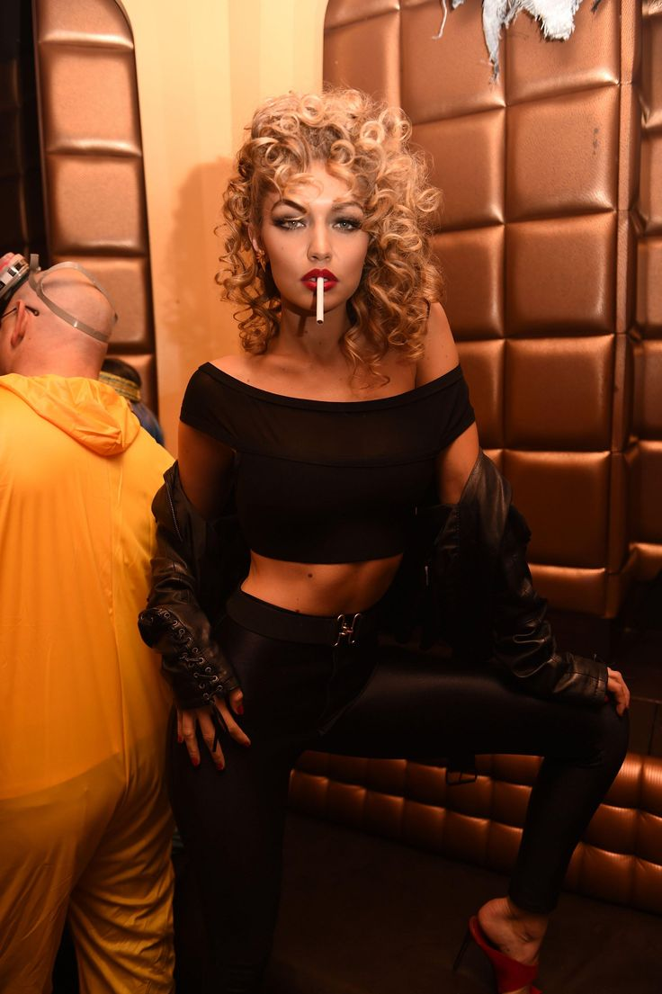 Gigi Hadid dressed up as Sandra Dee for Halloween wearing House of CB's cropped 'Roche' top and high-waisted black pants