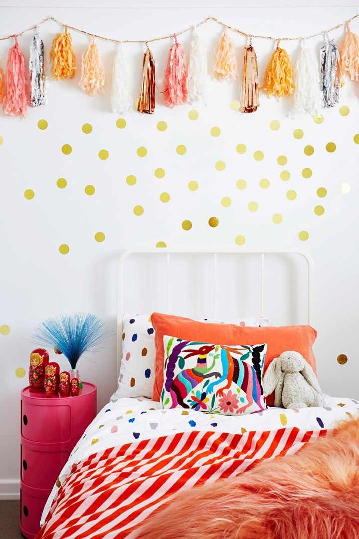 Kids bedroom with Confetti System tassels and gold dots on wall | Home Beautiful Magazine Australia