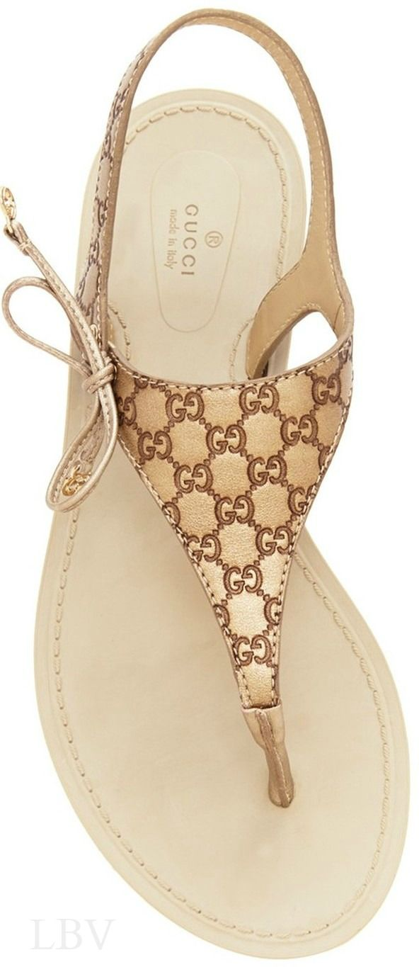 Gucci Gold Katina Leather Thong Sandals Soft leather sandals defined by a logo-embossed upper and bow detail. Color: champagne ★ DiamondB! Approved ★