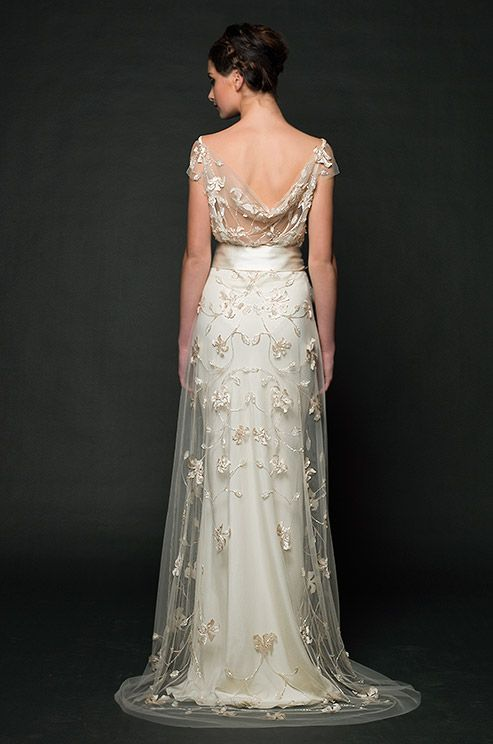 South African wedding dress designer Sarah Janks recently launched her Fall 2014 collection at New York International Bridal Market. The Forget Me Not collection, inspired by the flower for which it is named, utilizes delicate laces, beading, and floral appliqués to effortlessly portray femininity a