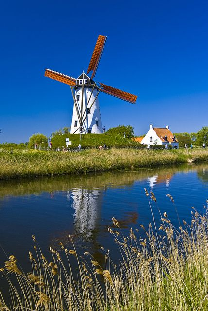 Windmill on the Canal Bruges, Damme, Flanders, Belgium. Photo: Vainsang via Flickr