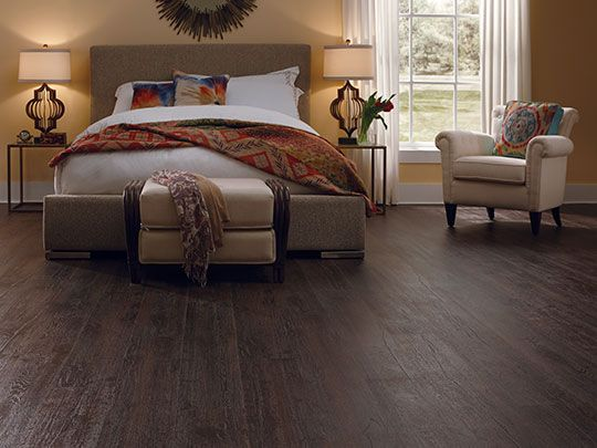 Dark laminate flooring creates a warm and comfort feel in this