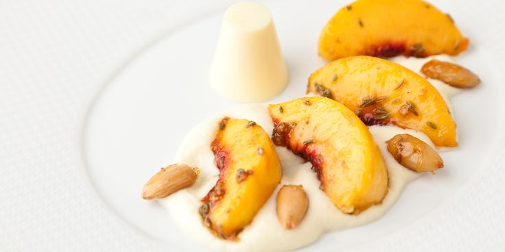 This sumptuous grilled peaches dish comes with  a white chocolate rabdi and a cardamom panna cotta recipe from brilliant Indian chef Vineet Bhatia.