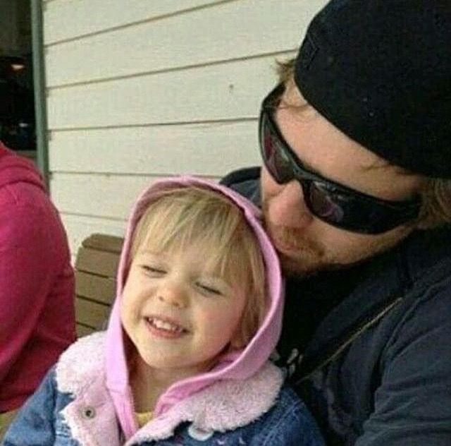 Dean Ambrose with a cute little girl