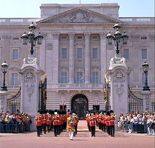 Buckingham Palace, London. Visitors watch the changing of the guard. Arrive no later than 10:30 a.m. to get a good spot.