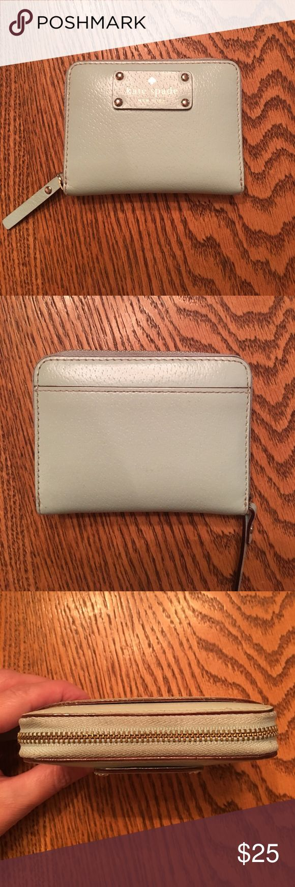 Kate Spade zip around coin card holder Authentic. Mint green. Gold tone zipper. Zipper has some staining. Inside has coin imprints.   Leather is in good condition. 4x3. Kate Spade Bags Wallets