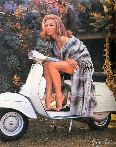 1960s ads for vespas crack me up. As if you could possibly ride a scooter wearing this (via: jackdresseswell)