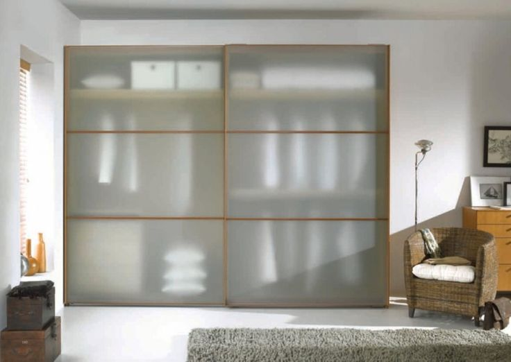 Semi Transparent Wardrobe Cabinet Plus Minimalist Rattan Chair Also Grey Shaggy Rugs Plus White Walls Design Ideas: Beautify Your Room with Modern Minimalist Wardrobe Designs