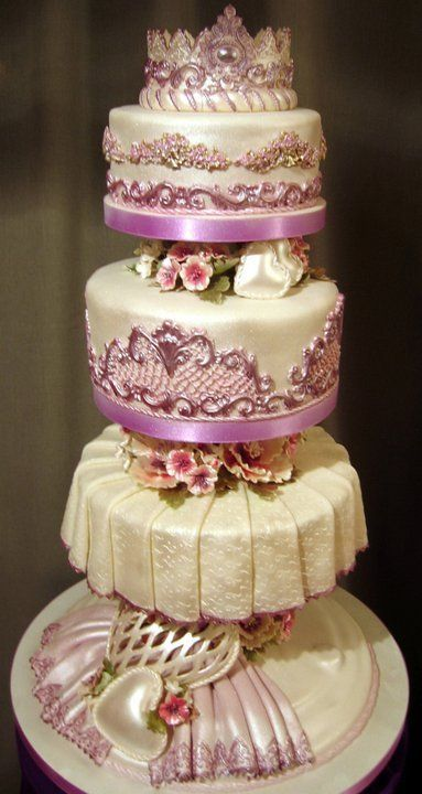 Disney princess crown purple and cream wedding cake.